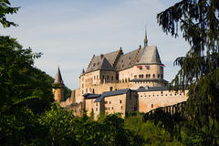 Medieval Castle of Vianden, Luxembourg. Vianden, Medieval castle on the mountain in Luxembourg or Letzebuerg, view through the trees - horizontal image Stock Photography