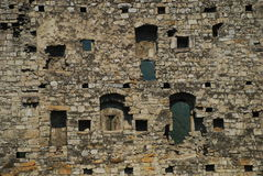 Medieval castle wall. The ruin of a medieval castle wall. Window pattern and stone construction texture stock images