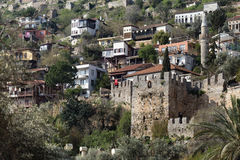 Medieval castle wall with old houses behind wall Royalty Free Stock Photography
