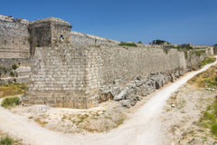 Medieval castle walls on Rhodes, Greece Royalty Free Stock Photo