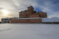 Medieval castle at winter. Snow covered medieval castle in the city of Hameenlinna, Finland at sunny winter day stock photography