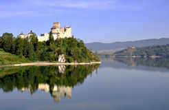 Medieval Castle Zamek Niedzica, Poland. Medieval castle Zamek Dunajec in Niedzica, Poland, built in 14th century, with artificial Czorsztyn lake on Dunajec river Royalty Free Stock Image