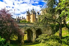 Medieval castles of Loire valley - beautiful Montreuil-Bellay. France. Impressive Montreuil Bellay medieval castle,view with old bridge and park,Loire valley stock photos
