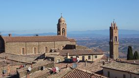 Medieval Catholic Church over the roofs of Montalcino. Tuscany, Italy. Medieval Catholic Church over the roofs of Montalcino. Tuscany. Italy stock video