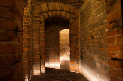 Medieval cellar. Old cellar in medieval castle, made of red bricks Royalty Free Stock Images