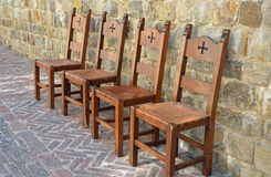 Medieval chairs on brick patio Royalty Free Stock Image