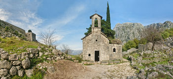 Medieval chapel in mountains panorama Royalty Free Stock Photography