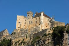The medieval Chateau de Beynac rising on a limestone cliff above the Dordogne River. France, Dordogne department, Beynac-et-Cazenac royalty free stock images