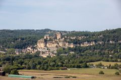 The medieval Chateau de Beynac rising on a limestone cliff above the Dordogne River. France,. Dordogne department, Beynac-et-Cazenac royalty free stock photo