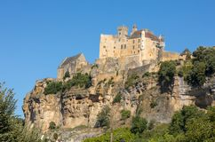 The medieval Chateau de Beynac rising on a limestone cliff above the Dordogne River. France. Dordogne department, Beynac-et-Cazenac stock images