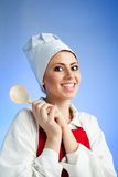 Medieval chef with wood spoon Stock Photo