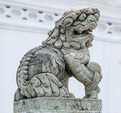 Medieval chinese guardian foo dog granite statue. Royalty Free Stock Photography