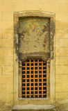 Medieval church door. On yellow wall Royalty Free Stock Image
