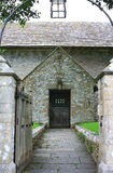 Medieval Church Entrance. The entrance gate leading to the door of a medieval church. Stone pillars visible at the gate entrance with a wrought iron arch with Royalty Free Stock Photos