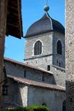 Medieval church framed with old buildings. And clear blue sky Stock Photos
