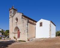 The medieval church of Santa Cruz with a Gothic portal. Stock Photos