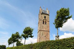 Medieval church tower  with saddleback roof Stock Photo