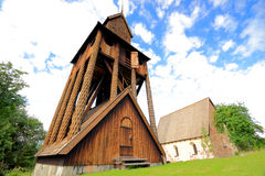 Medieval church and a wooden belfry Stock Image