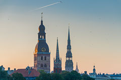 Medieval churches in old city of Riga at dawn Royalty Free Stock Photo