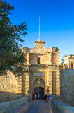 The medieval citadel of Mdina. Narrow stone bridge over a moat and a Baroque main gate constructed in 1724, entrance to  the Silent City, government and Stock Photography