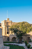 The medieval citadel of Mdina. Narrow stone bridge over a moat and a Baroque main gate constructed in 1724, entrance to  the Silent City, government and Royalty Free Stock Images