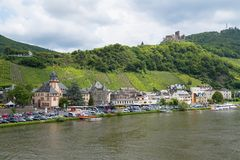 Medieval city Bernkastel with tourists making a river cruise Stock Photos