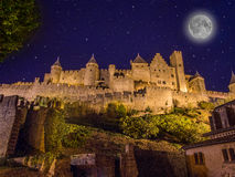 Medieval city of Carcassonne, France. At night with a full moon Stock Photos