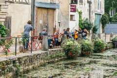 The medieval city of Chablis. The medieval town of Chablis in France.Tourists sit at tables street cafes. An ancient wine region. July 23, 2017 stock photo