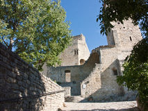 Medieval city of Le Poet Laval Drome France. Steep climbing cobblestone road and arch at the medieval town of Le Poet Laval in the Drome department Provence stock images