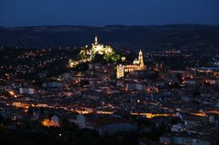 Medieval city by night. Le Puy-en-Velay, city situated among the extinct volcanoes in the south-central France (Auvergne, Haute-Loire) has its roots in the Stock Image