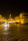 Medieval city by night light. Church St. Ulrich and Afra in Augsburg seen with christmas lighting in the night with busy traffic and people Stock Photography