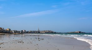 The medieval city of Saint Malo in Brittany, France. The medieval city and the villas of the seaside of Saint Malo in Brittany, France, seen from the beach Royalty Free Stock Image
