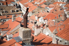 Medieval city view, rooftops and chimneys, tiles. Medieval city birds eye view, rooftops and chimneys, orange roof tiles Royalty Free Stock Photo