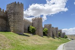 Wall os Avila. Medieval city wall built in the Romanesque style a sunny day , Avila, Spain Royalty Free Stock Photo