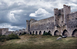 Medieval city wall defence. Medieval city wall in dark dramatic tones and colors Stock Image