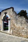 Medieval city wall with door arch in Porec,Croatia. Medieval city wall with door arch in Porec at Matije Gupca square Royalty Free Stock Image