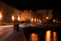 Medieval city walls in Rhodes town (night), Greece Stock Photo