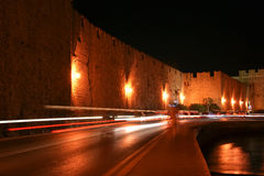 Medieval city walls in Rhodes town (night), Greece Stock Photography
