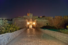 Medieval city walls in Rhodes town (night) Stock Photography
