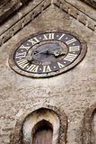 Medieval clock. On the church tower stock photography