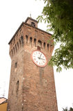 Medieval clock tower. Tall, ancient, medieval clock tower.  Northern Italy Stock Photos
