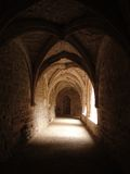 Medieval cloister with vaulted arches Royalty Free Stock Photos