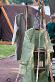 Medieval Clothes. Medival dealer is offering clothes in a medieval camp royalty free stock photo