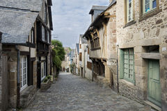 Medieval Cobbled Street in Dinan, Brittany, France Stock Photos