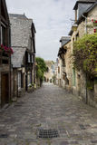 Medieval Cobbled Street in Dinan, Brittany, France Royalty Free Stock Image