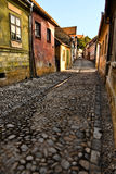 Medieval cobblestone paved road. Cobblestone paved road. The Sighisoara Citadel is the old historic center of the town of Sighisoara, Romania, built in the 12th Stock Photos