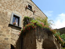 Medieval construction. With balcony and Flowers in Bagnnioregio, Italy Stock Photos