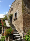 Medieval construction. With stairs and Flowers in Bagnioregio, Italy Stock Photos
