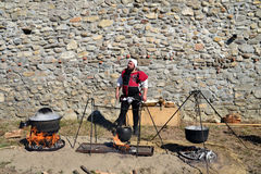 Medieval cooking outdoors Royalty Free Stock Image