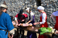 Medieval cooking people Stock Photos